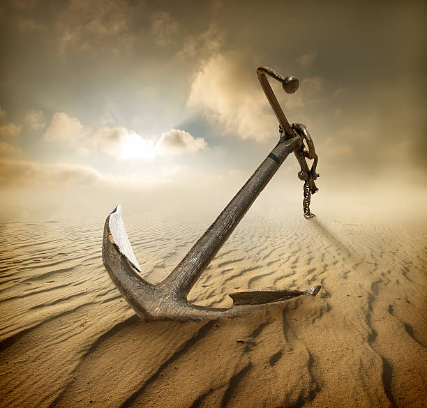 Anchor in desert Anchor in the desert and cloudy sky anchor stock pictures, royalty-free photos & images