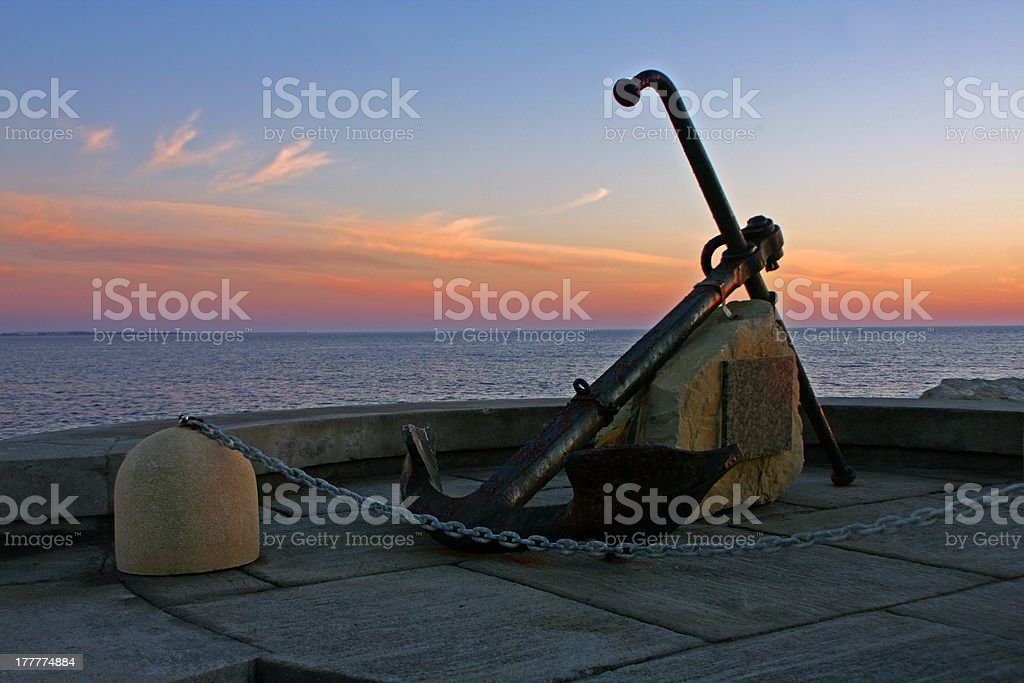 anchor in the sunset stock photo