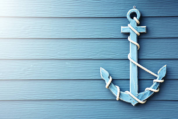 Anchor on blue wooden background. Beautiful anchor on blue wooden background. anchor stock pictures, royalty-free photos & images