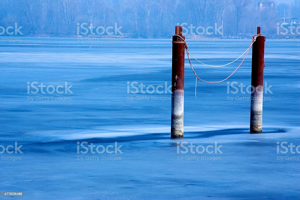 Anchor piles in the lake stock photo