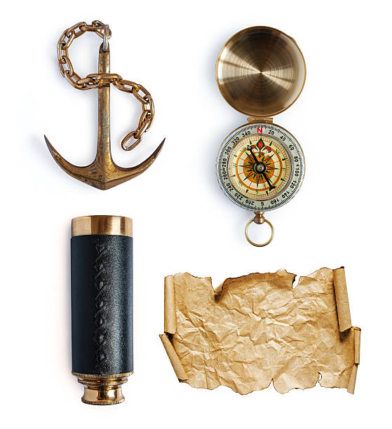 Anchor, telescope, compass and map or parchment Retro nautical collection: anchor, telescope, compass and map or parchment isolated on a white anchor athlete stock pictures, royalty-free photos & images