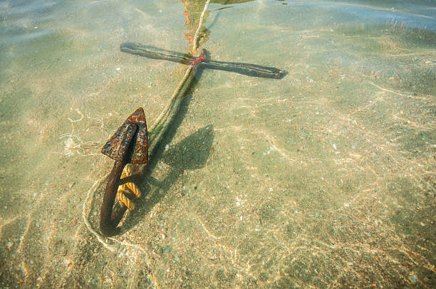 anchor under the sea stock photo