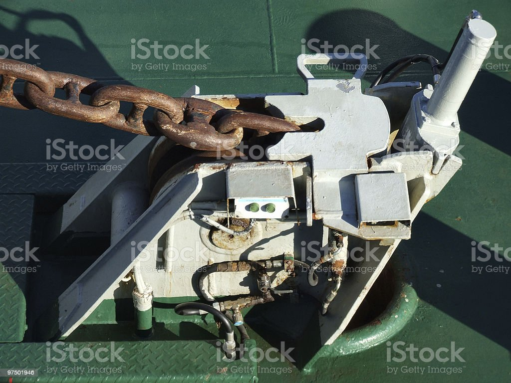 Anchor winder device on a ship royalty-free stock photo