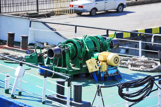 anchor windlass with chain - cable winch stock photos and pictures