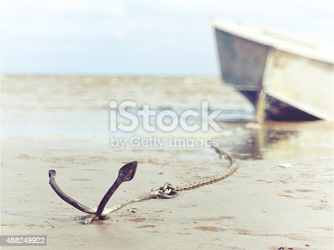 istock anchored on the shore with boat 488249922