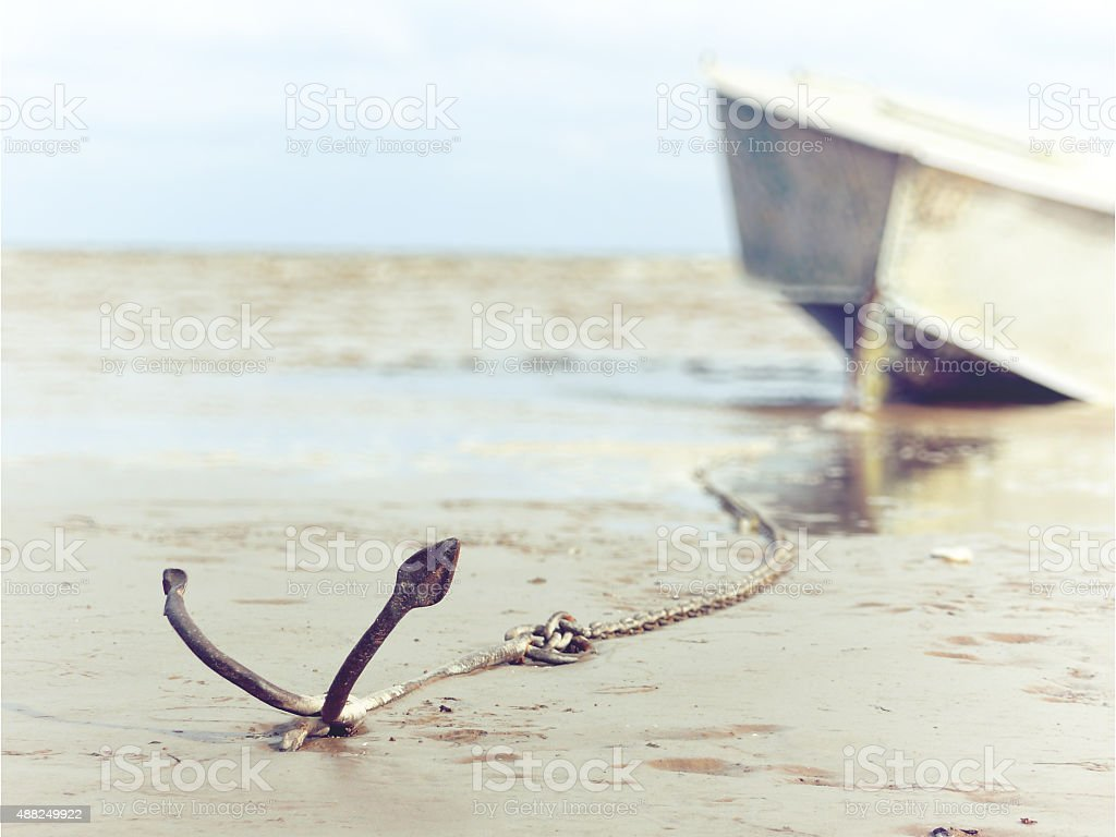 anchored on the shore with boat stock photo