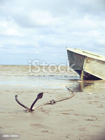 istock anchored on the shore with boat 488249934