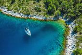 Anchored sailboat at Dugi island, Croatia. High angle view from drone.