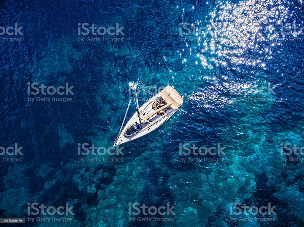 Anchored sailboat, view from drone