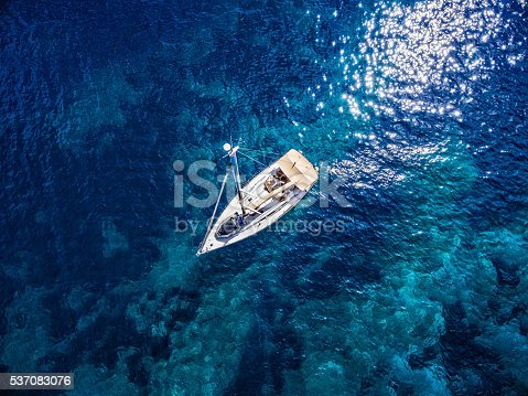 Anchored sailboat, high angle view from drone Phantom 3. Model released.
