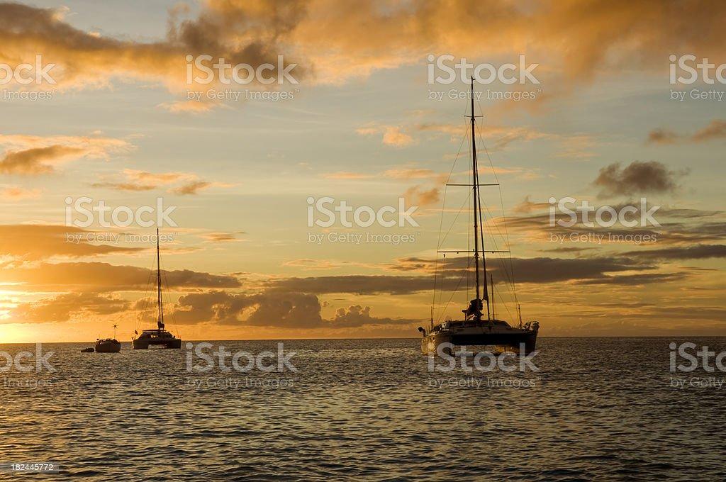 Anchoring ships at sunset royalty-free stock photo