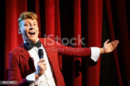istock Anchorman talking to spectators and announcing show 494279511