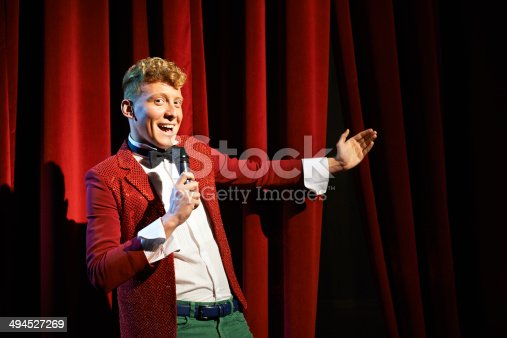 istock Anchorman talking to spectators and announcing show 494527269