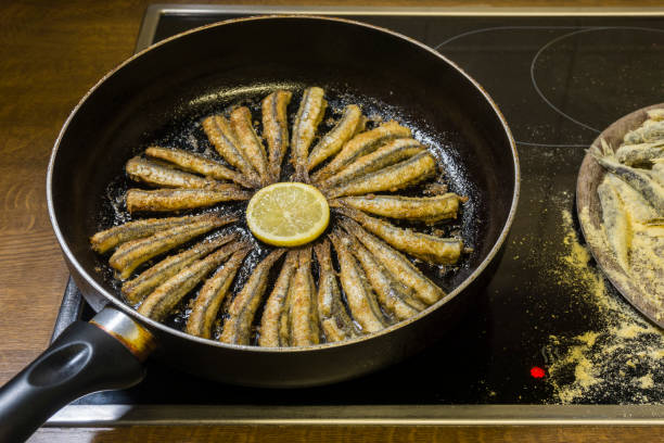 Anchovies cooked Cooked anchovies in a pan anchovy stock pictures, royalty-free photos & images
