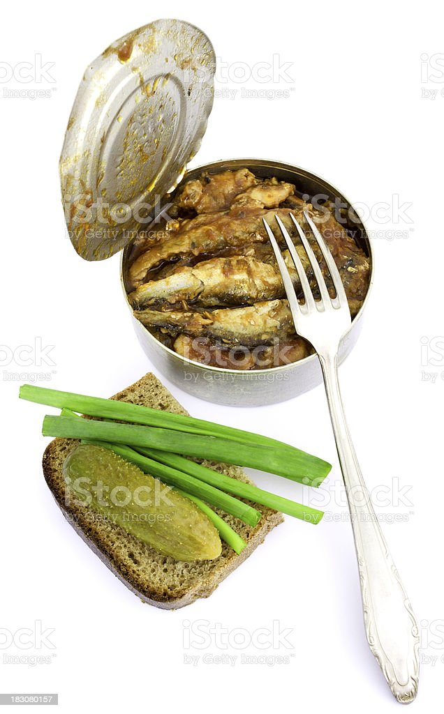 Anchovies in a tin can with rye bread royalty-free stock photo
