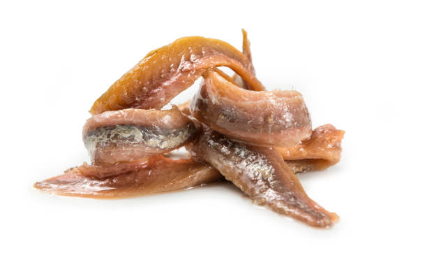 Anchovies Anchovies fillet over white background anchovy stock pictures, royalty-free photos & images