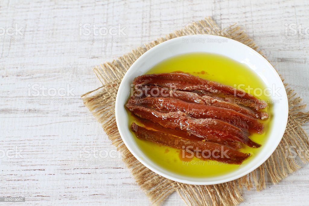 Anchovy fillets in olive oil stock photo