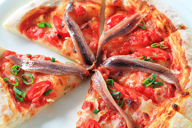Anchovy pizza Pizza with anchovies and red pepper anchovy stock pictures, royalty-free photos & images