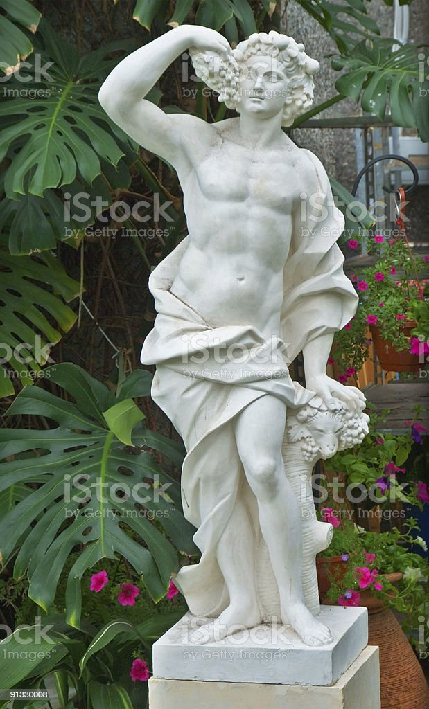 Ancien statue in the garden stock photo