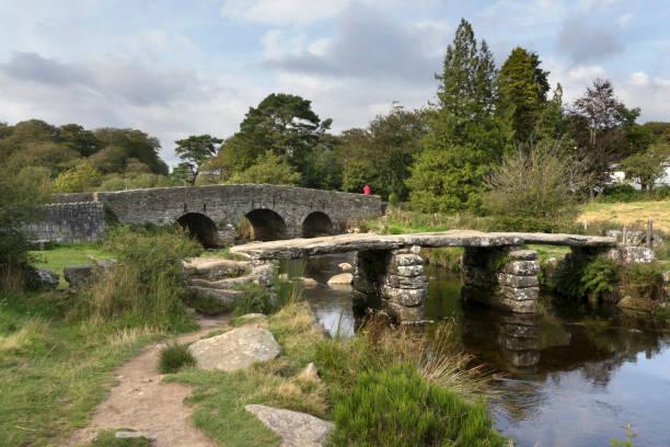 Ancient 13th century clapper bridge East Dart River Postbridge Dartmoor National Park Devon England stock photo