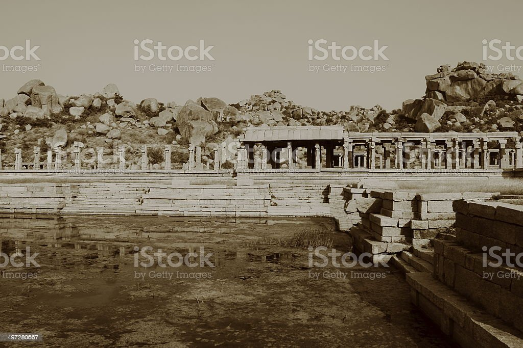 Ancient abandoned pool in Hampi (ancient Vijayanagar empire) stock photo