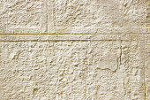 Ancient, abstract, ancient background of beige plaster, cement, gypsum. Copy space