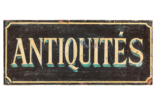 Old advertisement sign with the French text