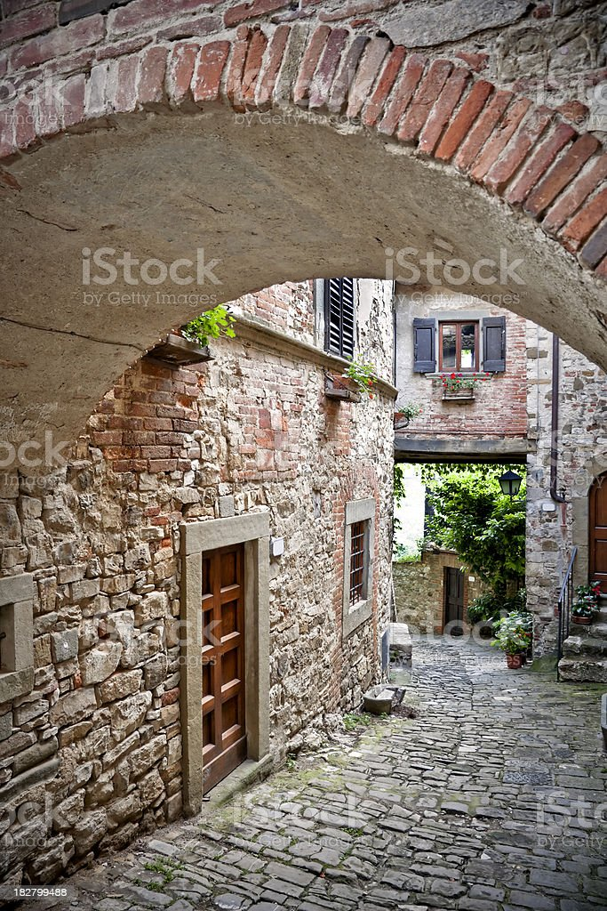 Ancient Alley with Arch in a Tuscan Village, Chianti Region stock photo