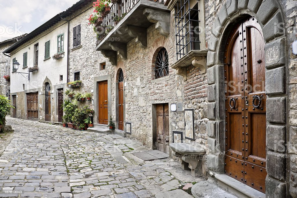 Ancient Alley with Wooden Doors in Tuscan Village, Chianti Region stock photo