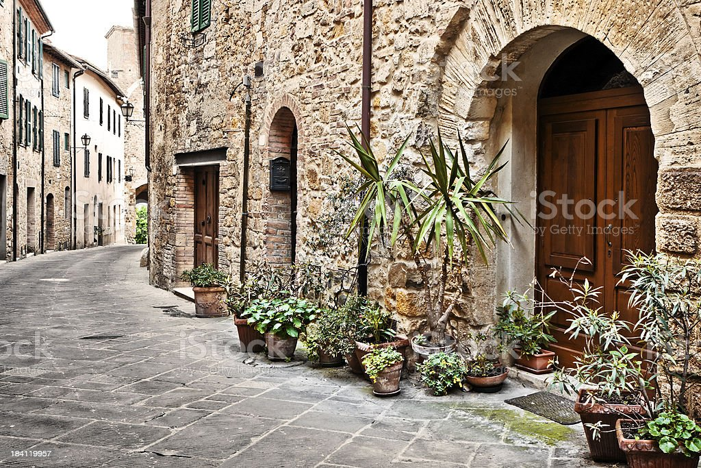 Ancient Alleyway with Wooden Door in Tuscan Village, Val d'Orcia royalty-free stock photo
