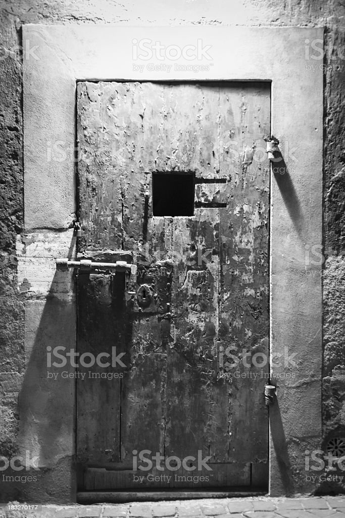 Ancient and rusty prison door royalty-free stock photo