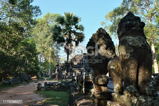 Ancient animal sculptures near the Banteay Kdei temple. Ancient ruins in the rainforest.