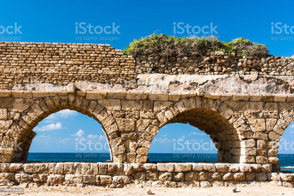 Ancient aqueduct on the Mediterranean coast stock photo