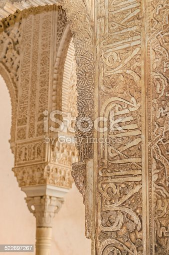 121178604istockphoto Ancient Arabic caligraphy detail in a column. 522697267