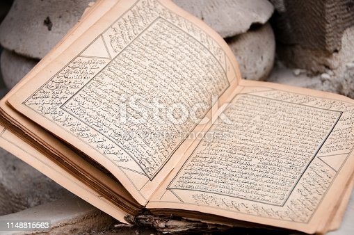 Ancient arabic manuscript with burnt pages close up