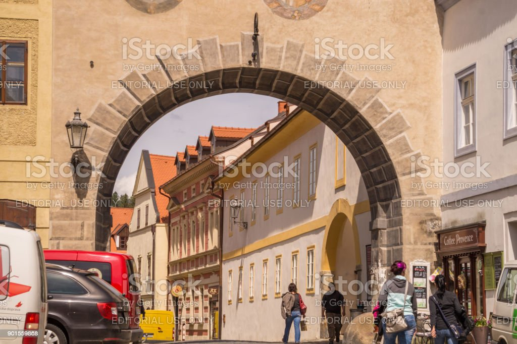 Ancient architecture of Europe. Narrow medieval streets of the city of Cesky Krumlov and pedestrians on the streets stock photo