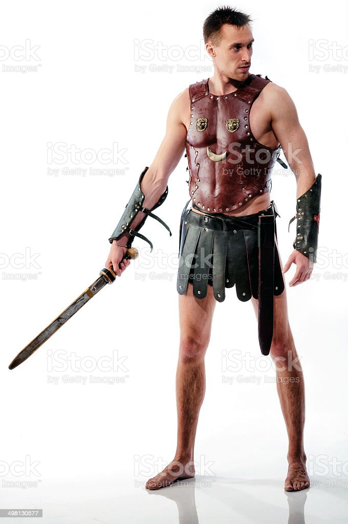 Ancient armed gladiator soldier with sword isolated stock photo