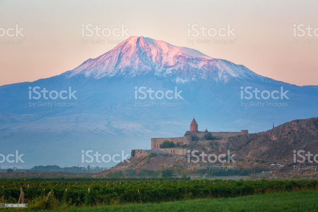 Ancient Armenian church Khor Virap with Ararat in sunrise stock photo