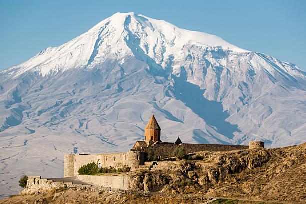 ancient armenian church khor virap with ararat on the background - klosterurlaub stock-fotos und bilder