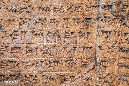 istock Ancient Assyrian and Sumerian cuneiform writing carving on stone from Mesopotamia. 1158422484