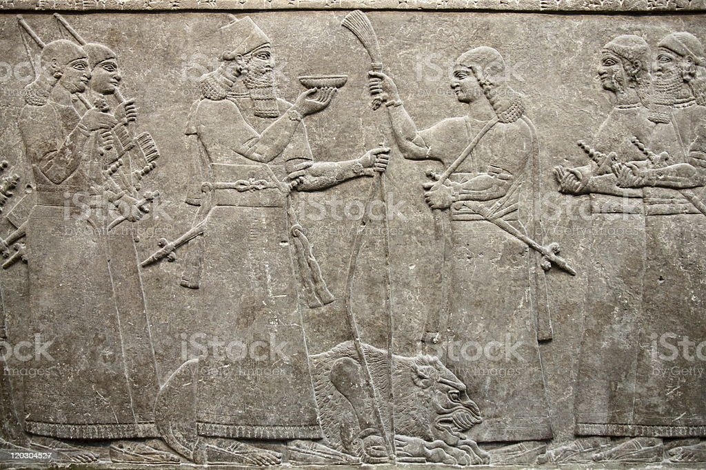 Ancient Assyrian Relief Of King Ashurnasirpal stock photo