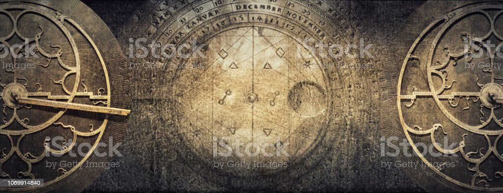Ancient astronomical instruments on vintage paper background. Abstract old conceptual background on history, mysticism, astrology, science, etc. Retro style. stock photo