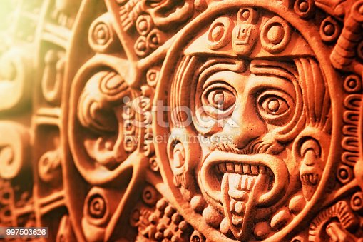 A modern ceramic reproduction of the ancient calendar known as the Stone of the Sun, carved by Aztecs in the 1500s.