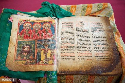 istock Ancient Bible in Amharic language, Aksum, Ethiopia. 528932181