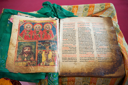 istock Ancient Bible in Amharic language, Aksum, Ethiopia. 528932181