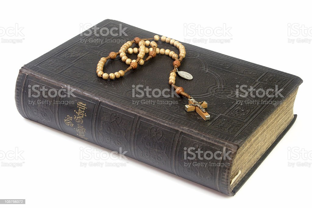 Ancient bible with rosary stock photo