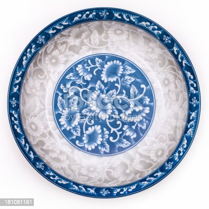 Ancient blue and white porcelain plate, isolated on white.