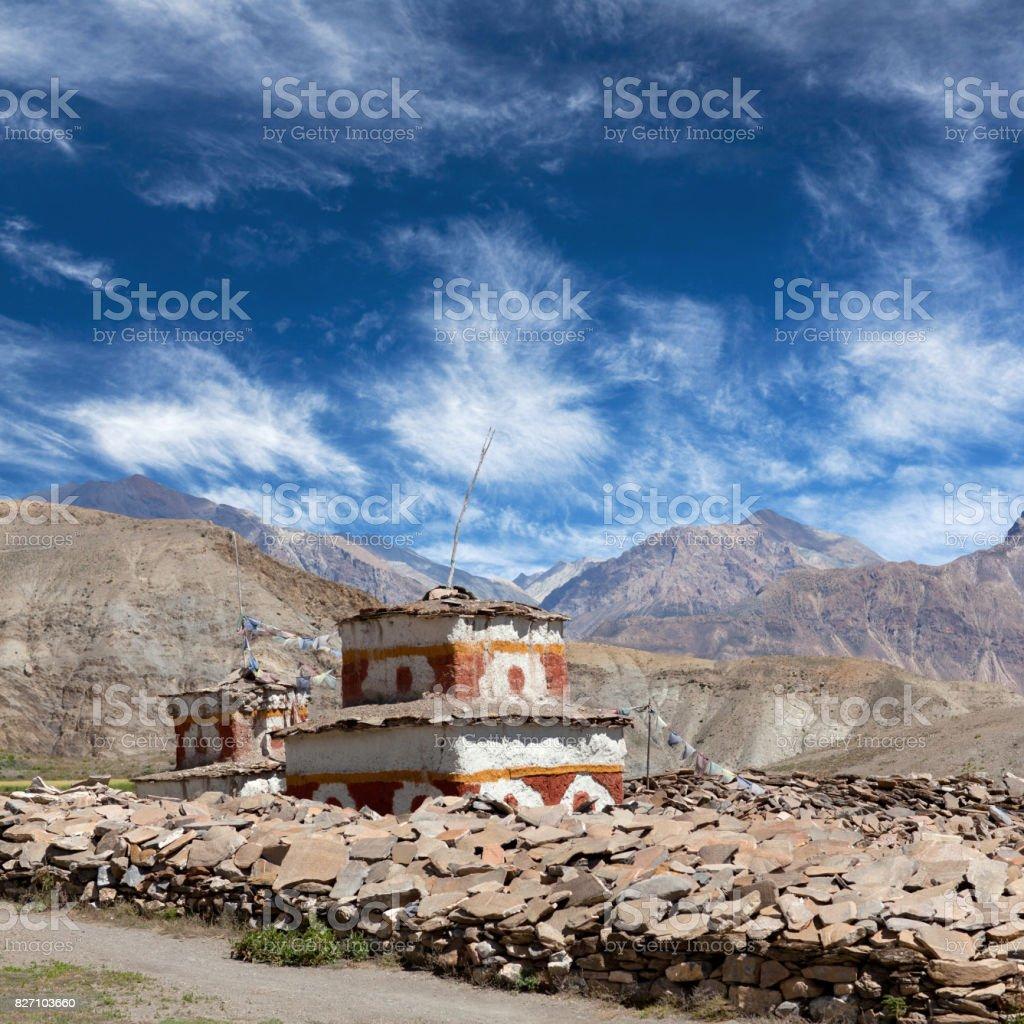 Ancient Bon stupa over mani stones in Dolpo, Nepal stock photo