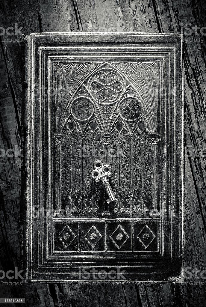 Ancient Book and Key stock photo