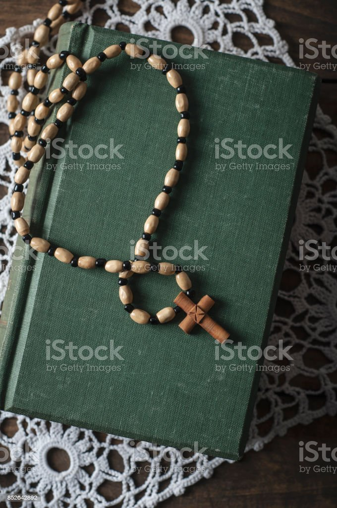 Ancient book and rosary stock photo